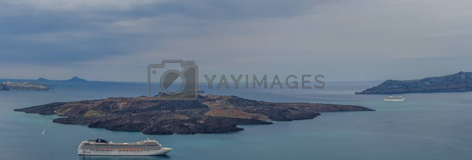 cruise ships near an island in the sea panorama view