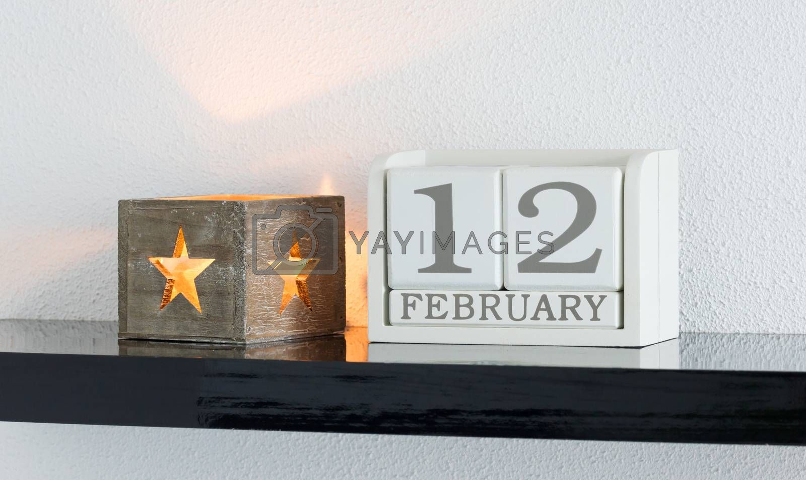 White block calendar present date 12 and month February by michaklootwijk