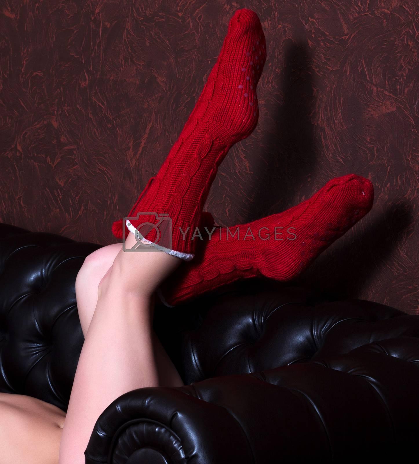 Female legs in red knitted socks