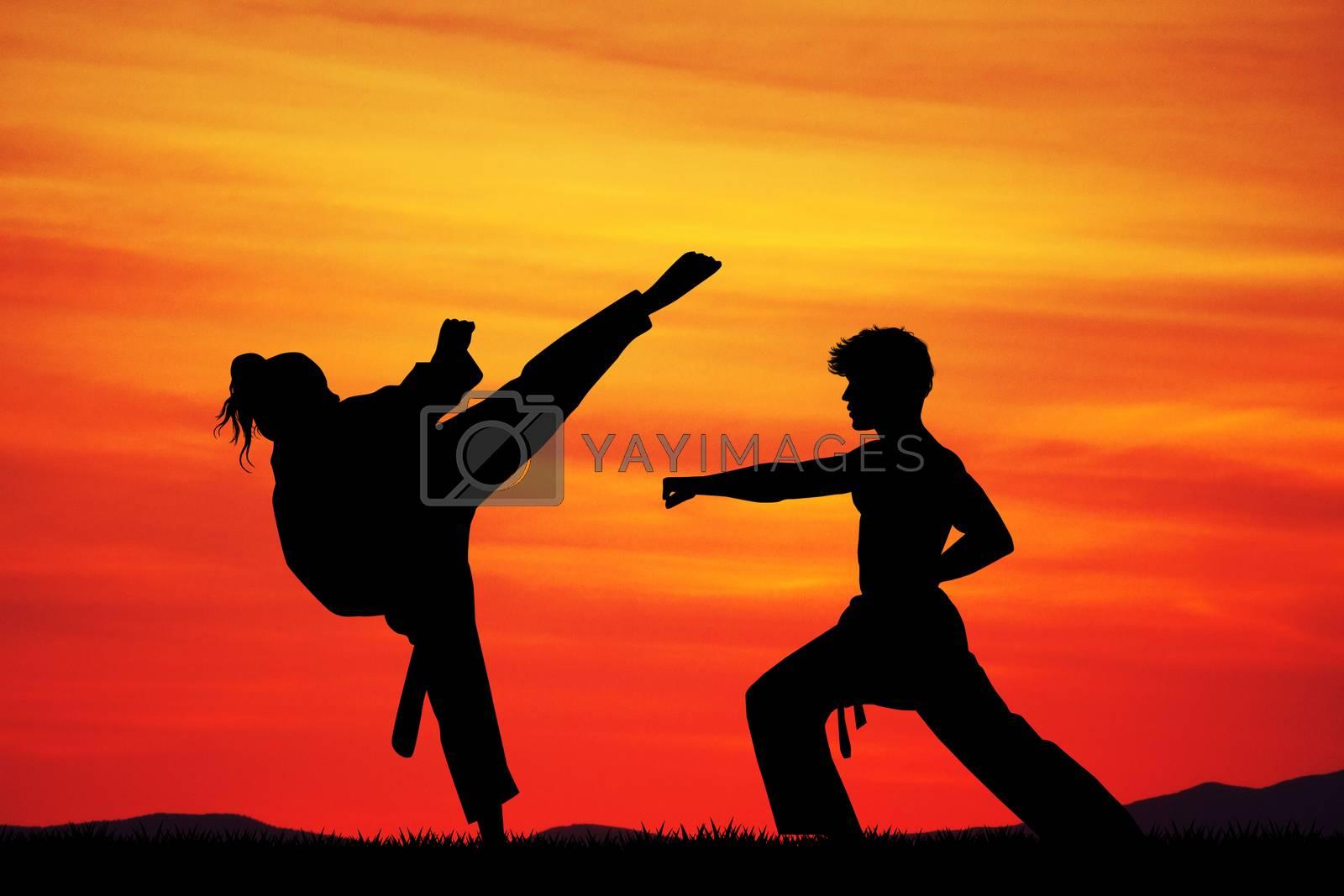 man and woman doing karate at sunset by adrenalina