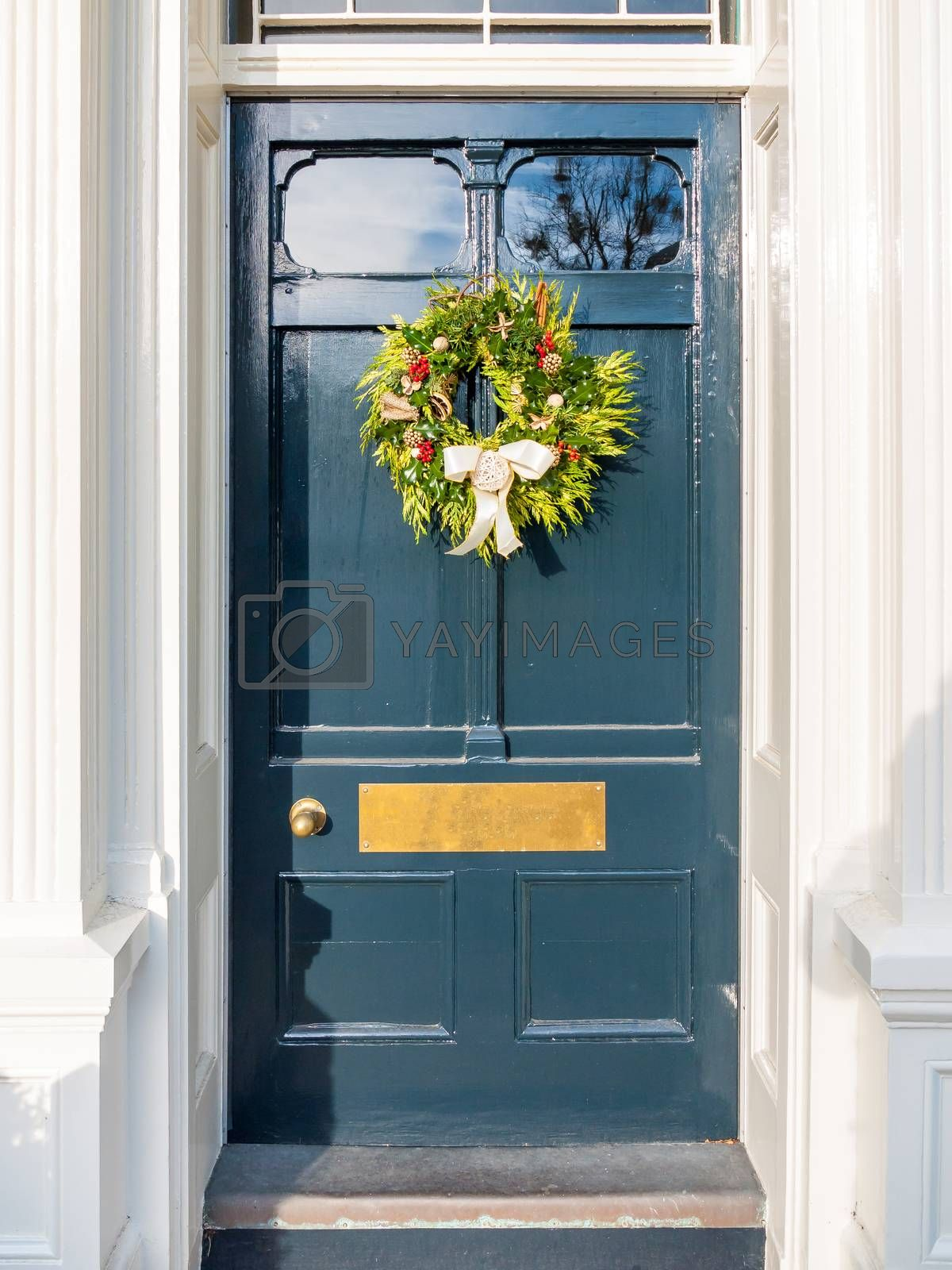 christmas wreath on blue country front door house by callumrc