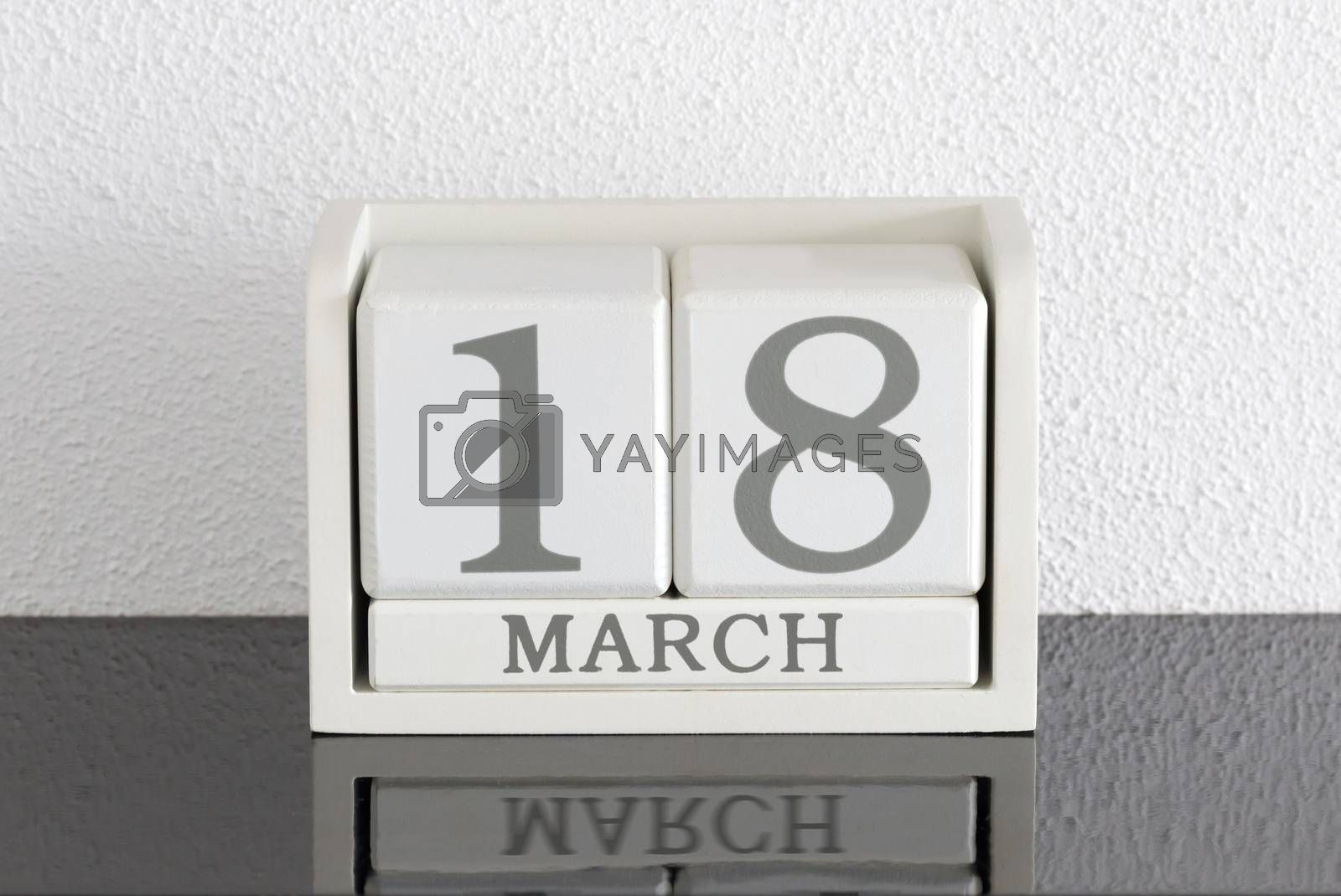 White block calendar present date 18 and month March by michaklootwijk