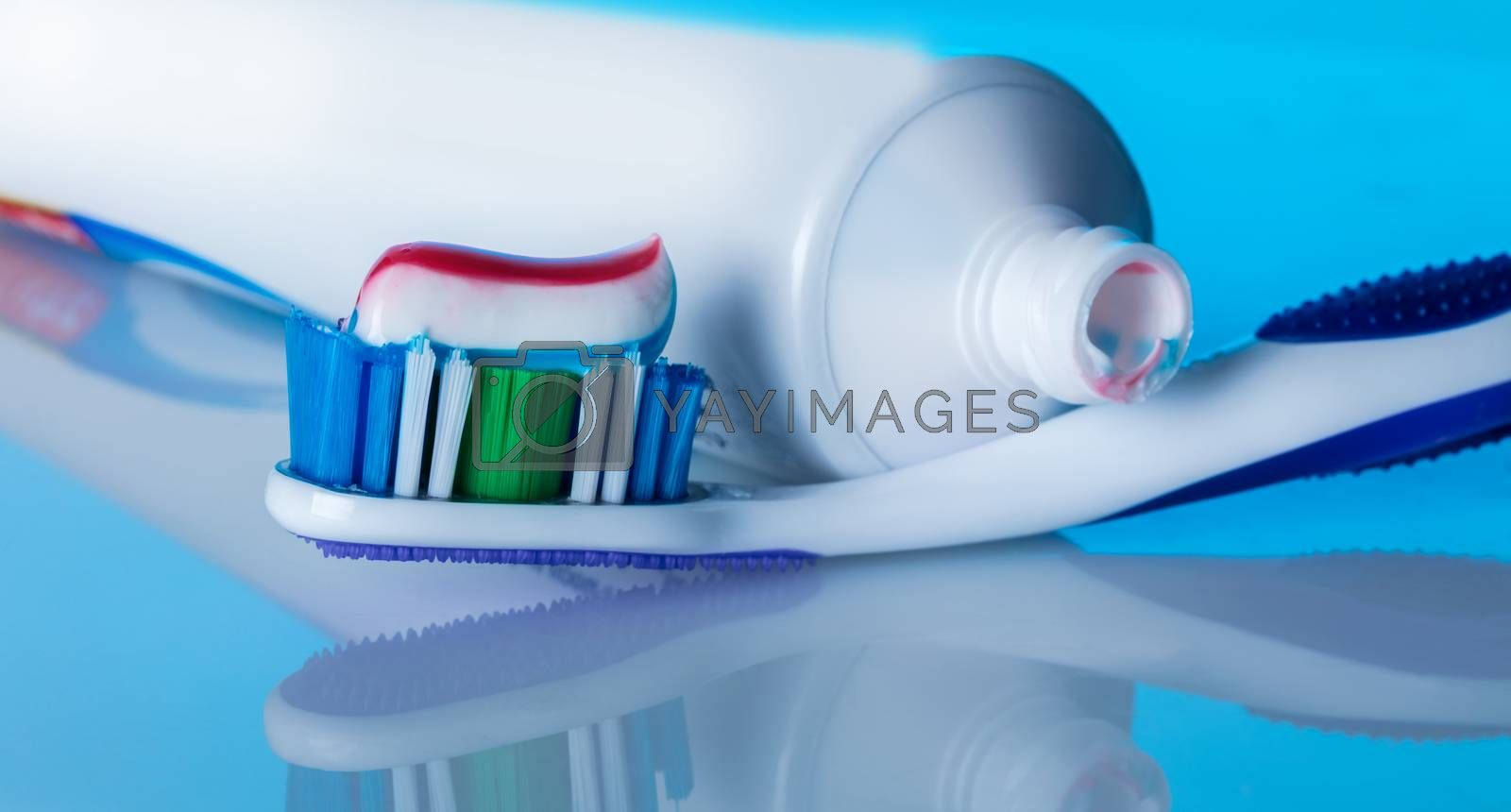 toothbrush with paste  by AlexPhoto