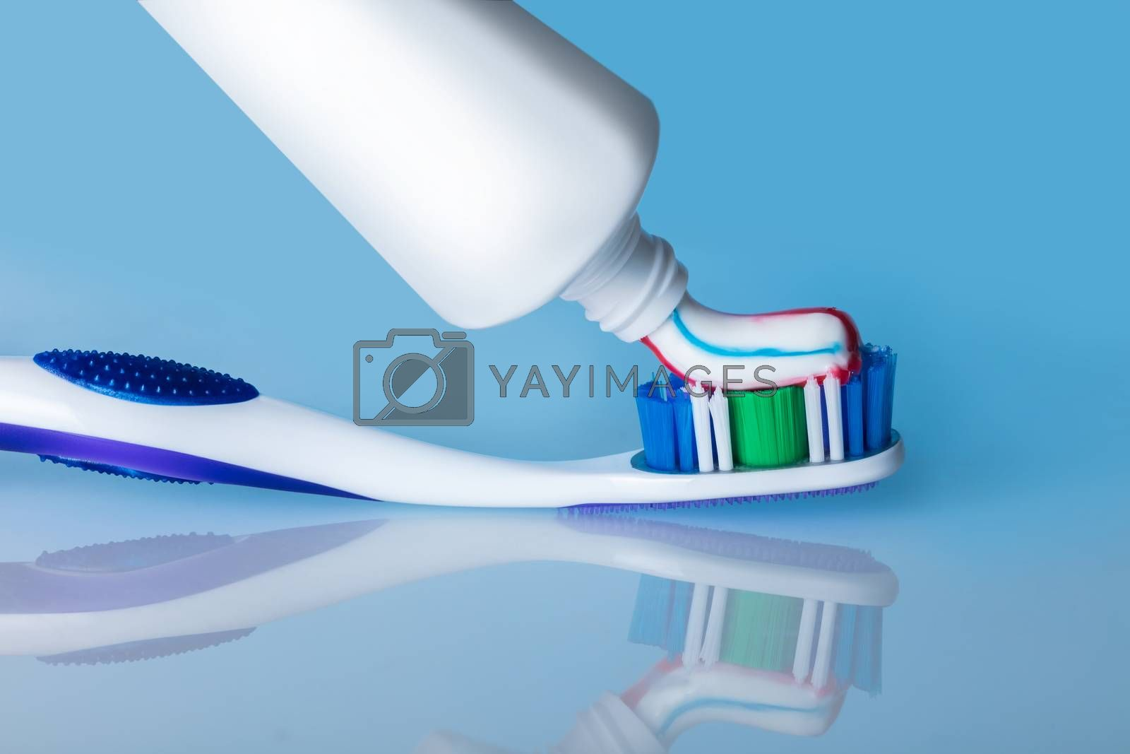 toothbrush with paste with reflection by AlexPhoto