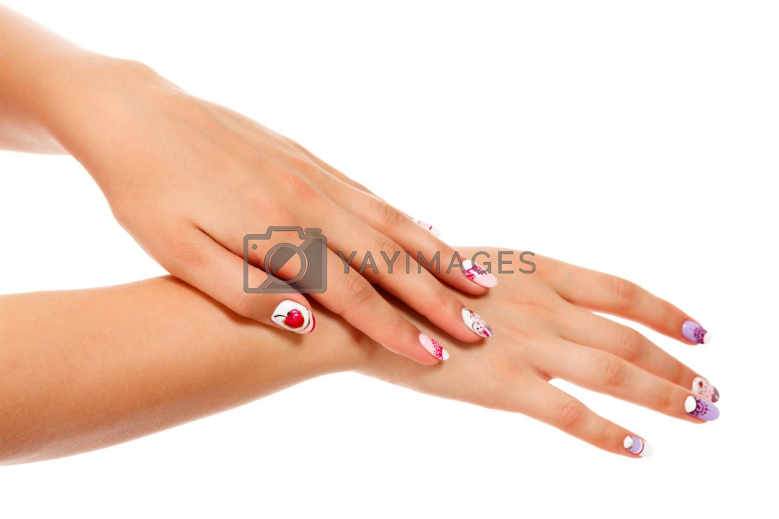 Closeup shot of beautiful female hands with manicured nails, isolated on white background