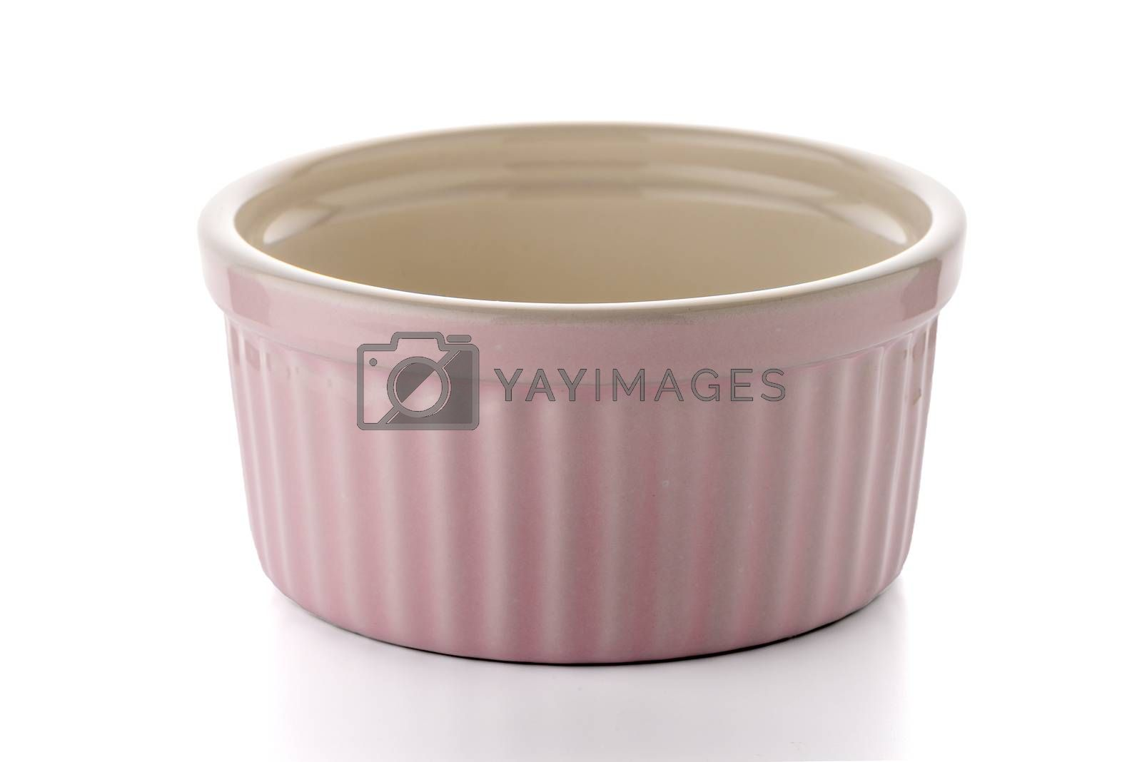 Pink ceramic bowl on white reflective background