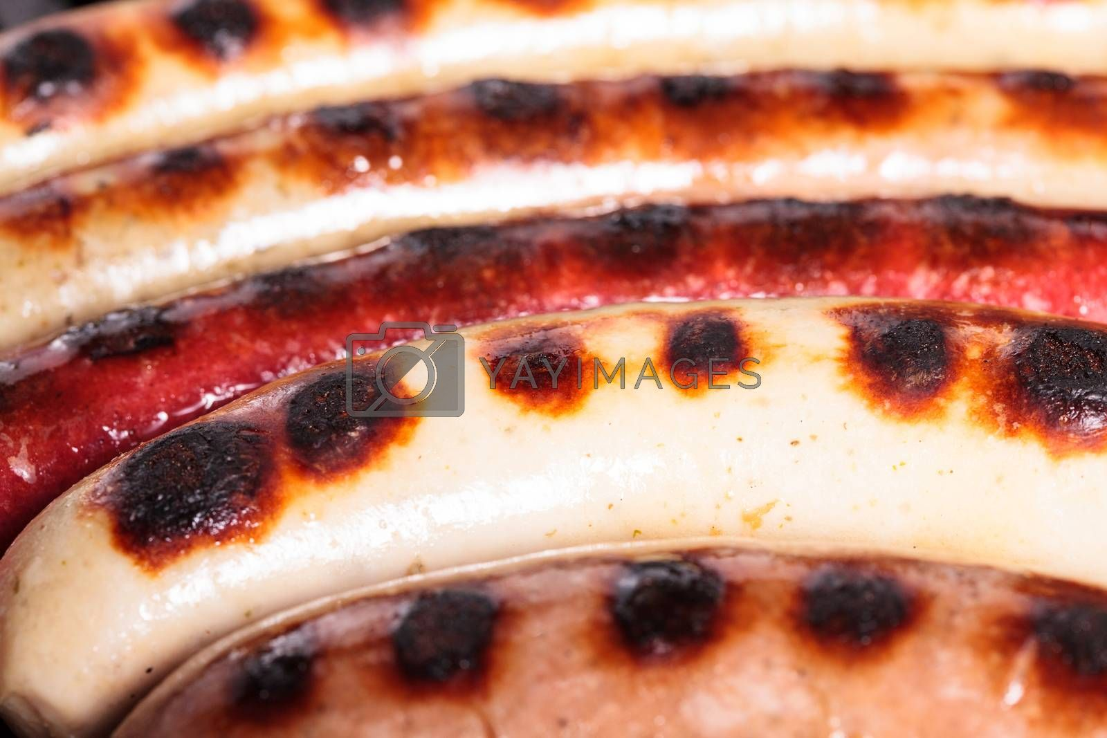 Closeup shot of sausages on a grill
