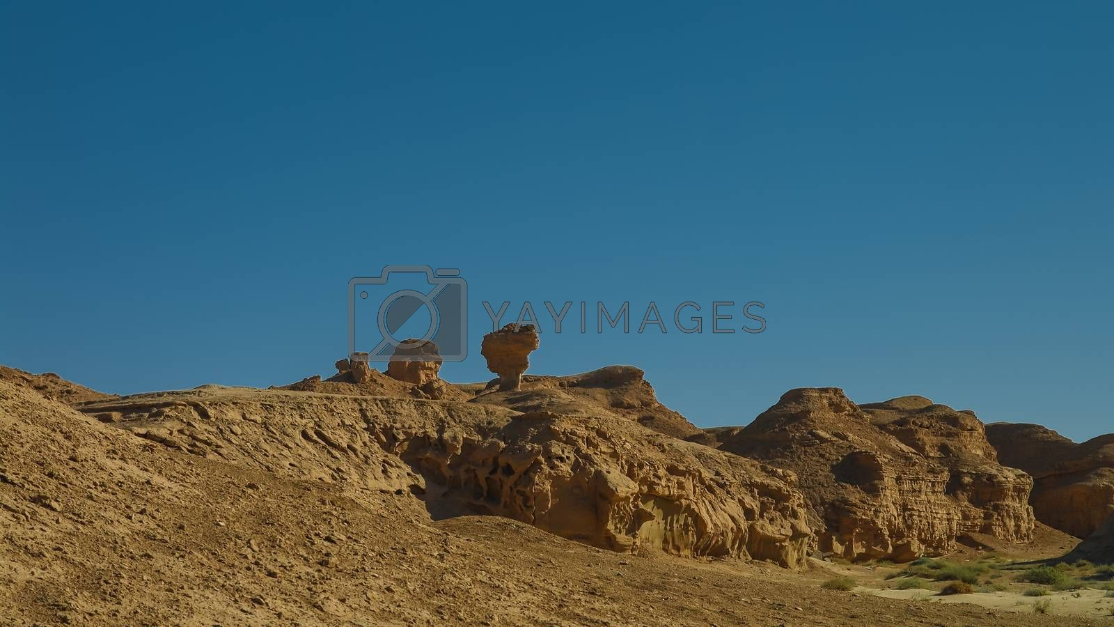 Buttes at the dried shore of Razazza lake Iraq by HomoCosmicos