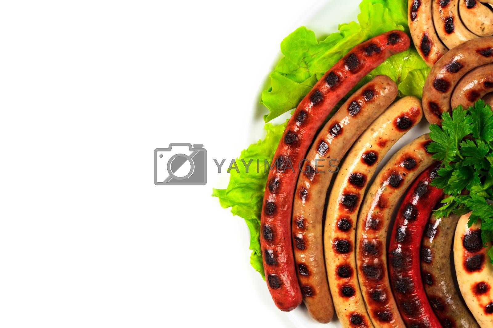 Closeup shot of a dish full of grilled sausages, isolated on white background. Flat lay