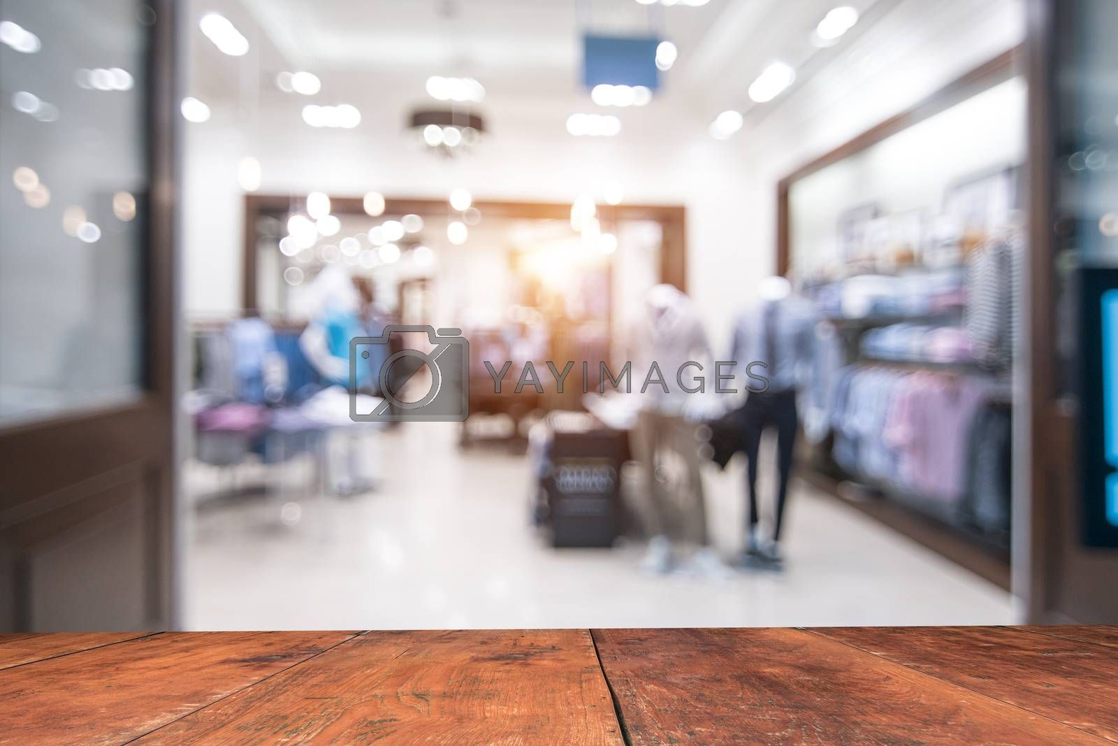 blurry background of Sports clothing store with bokeh image luxury and fashionable brand,can be used for montage or display your products