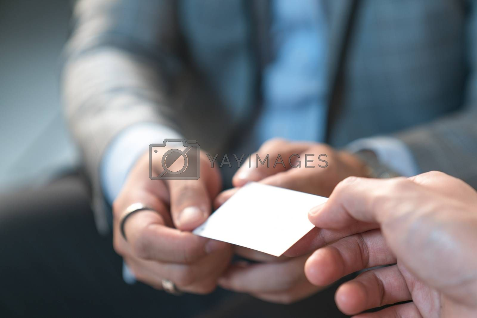 business executive exchanging business card businessman