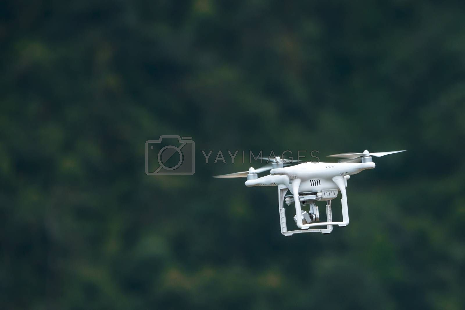 drone quad copter with high resolution digital camera on the sky
