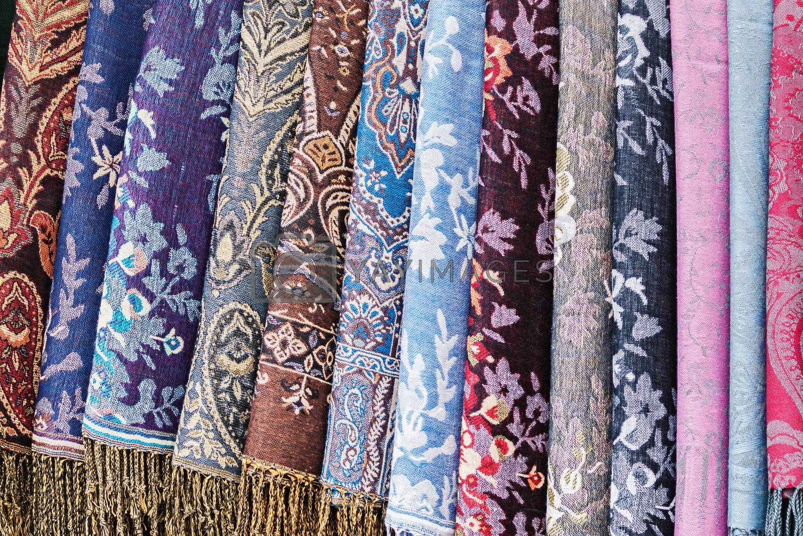 Rolls of decorative fabric as colorful textile background