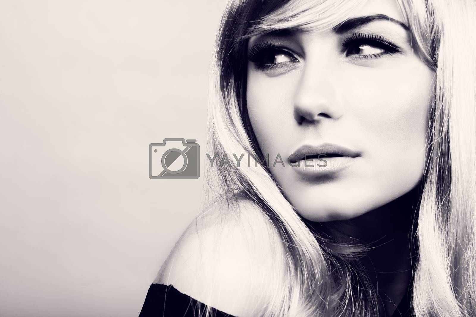 Closeup portrait of a gorgeous blond model, fashion look, beautiful makeup and hairstyle, black and white photo with copy space