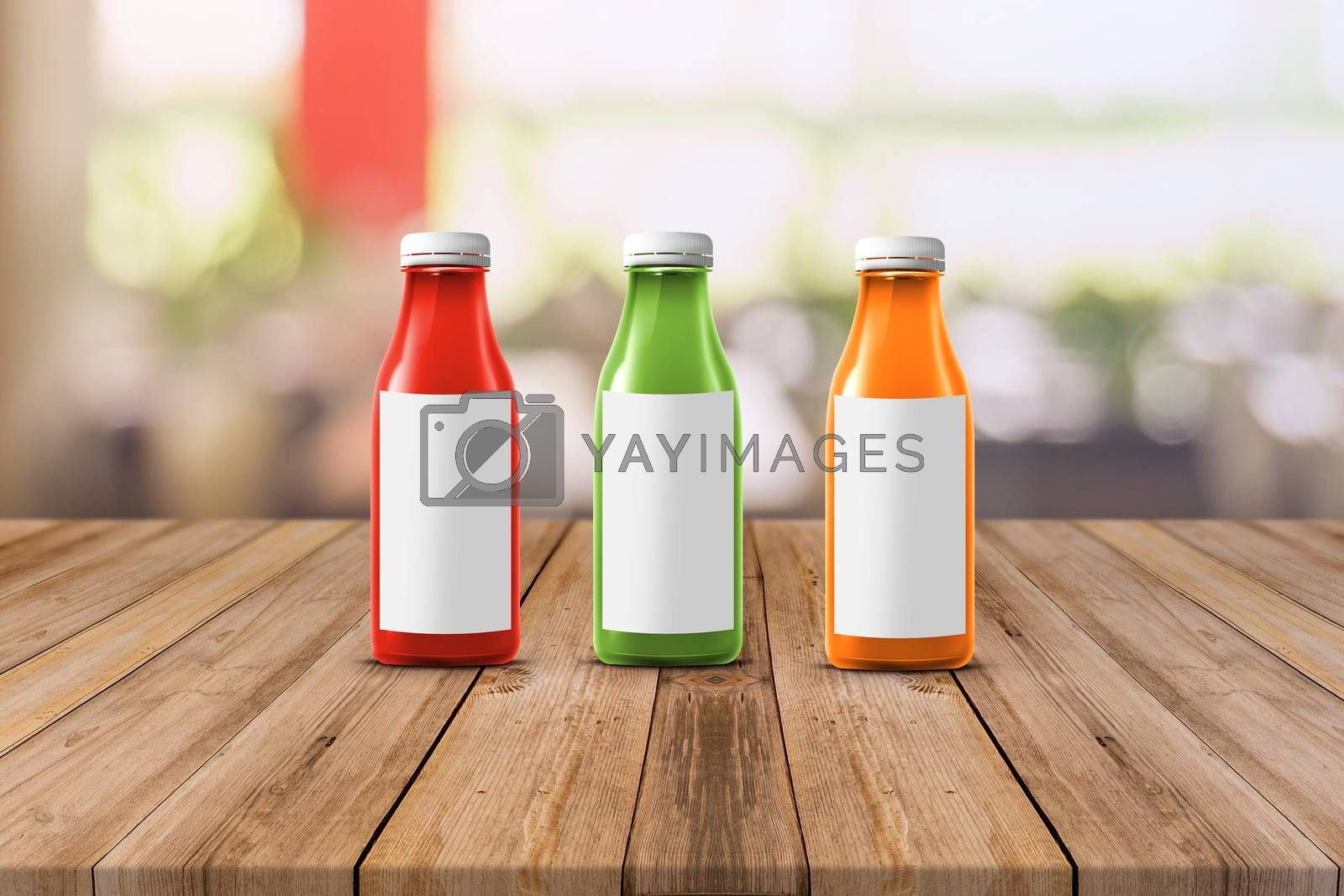 three multicolored bottles of juice are on the counter