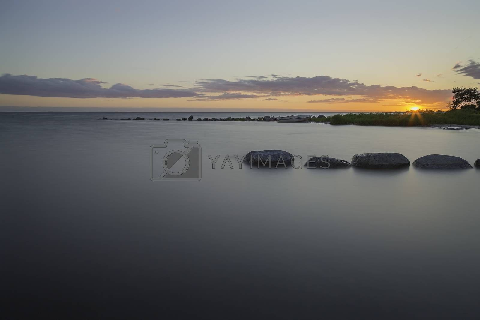 Sunset over Ocean with Breakwater by Emmoth