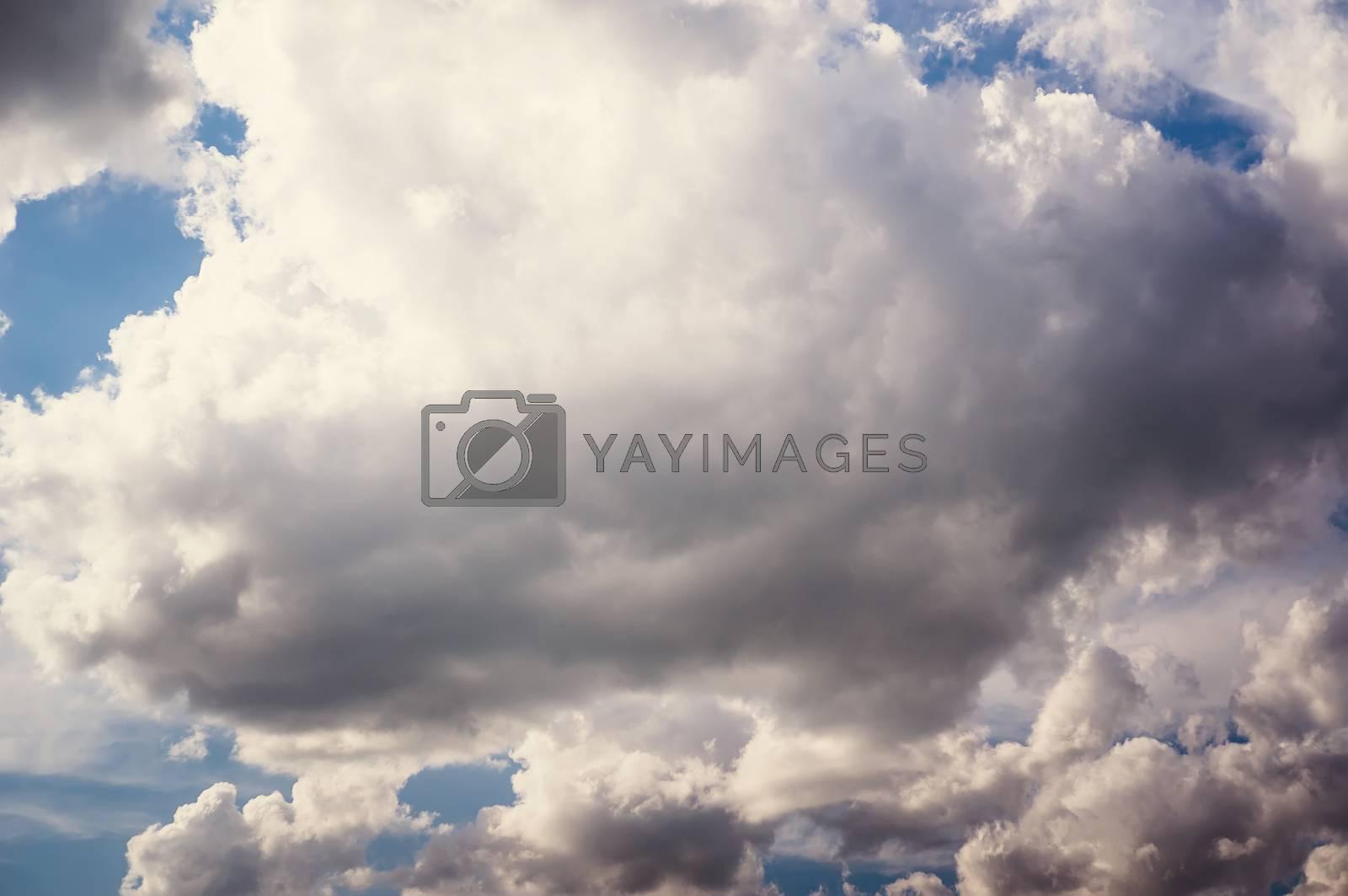 white clouds in the blue sky. Cumulus clouds