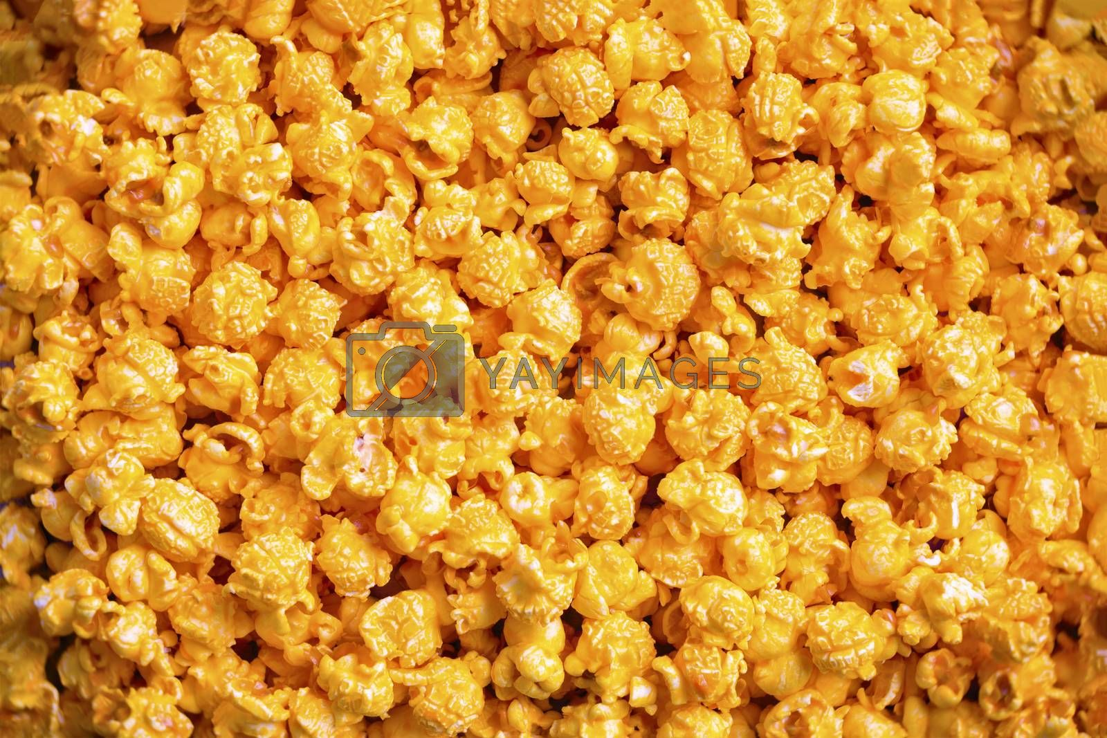 close up of golden cheese popcorn food background