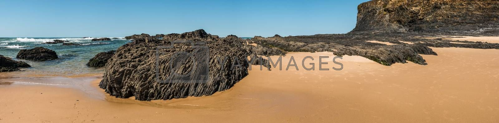 Beach with rocks in Almograve by homydesign