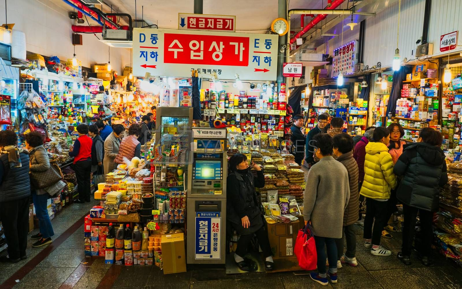 seoul, south korea - 11th november 2017: crowds at the  colorful traditional grocery market selling a zillion items