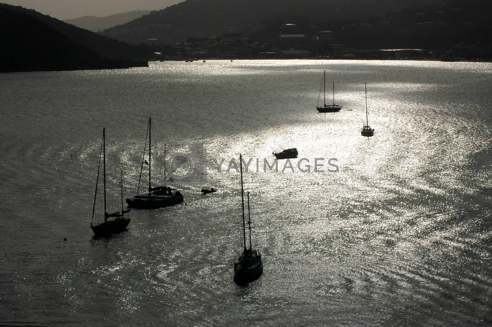 Sail boats at sunset by Peric