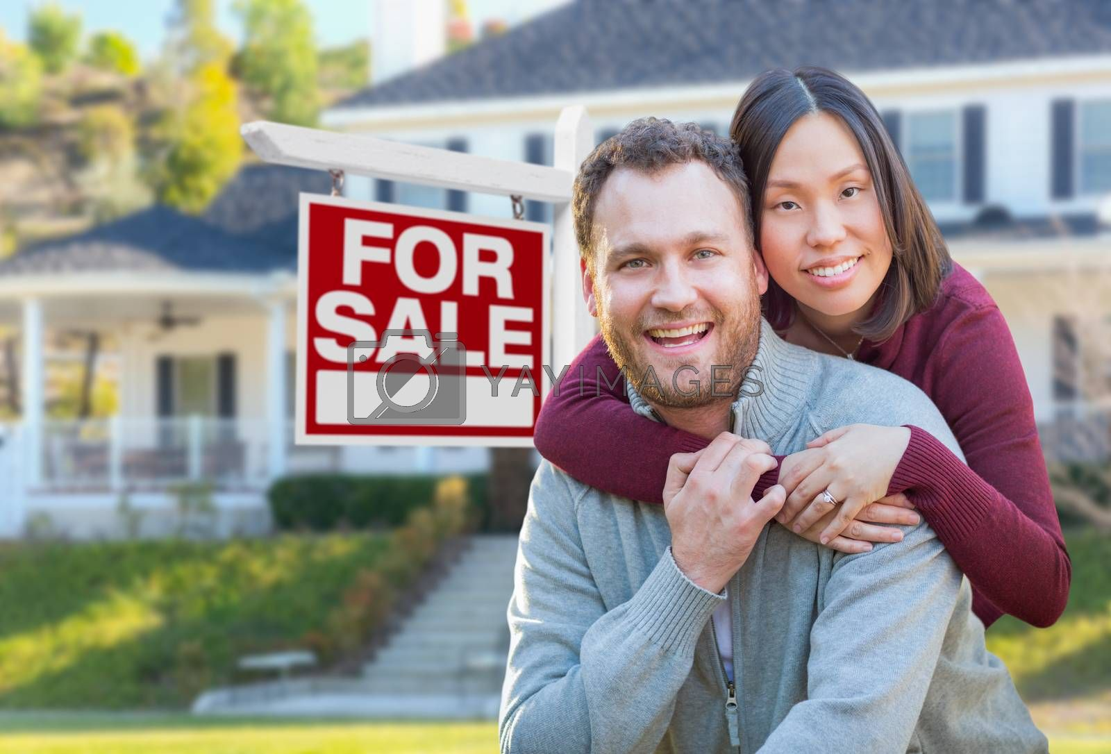 Mixed Race Caucasian and Chinese Couple In Front of For Sale Real Estate Sign and House. by Andy Dean Photography