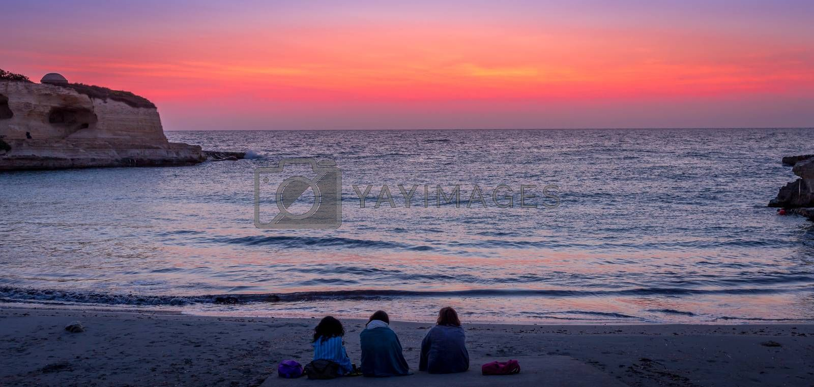 Three friends looking to the sunrise by Paolo Gallo