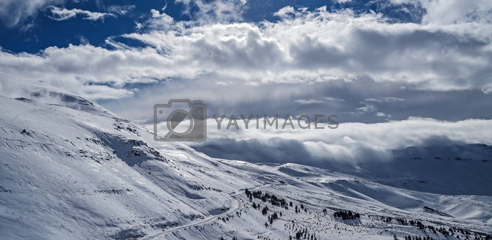 Beautiful winter landscape, high mountains covered with white snow on bright sunny day, Cedars Mountains, Lebanon