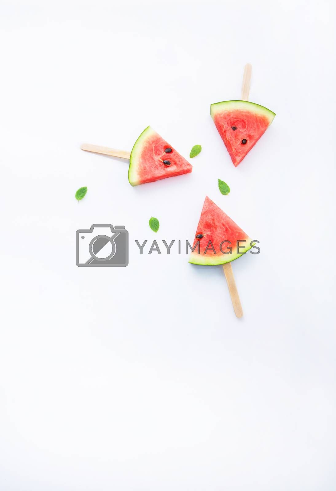 Fresh and sweet watermelon slice popsicles on white background by Bowonpat