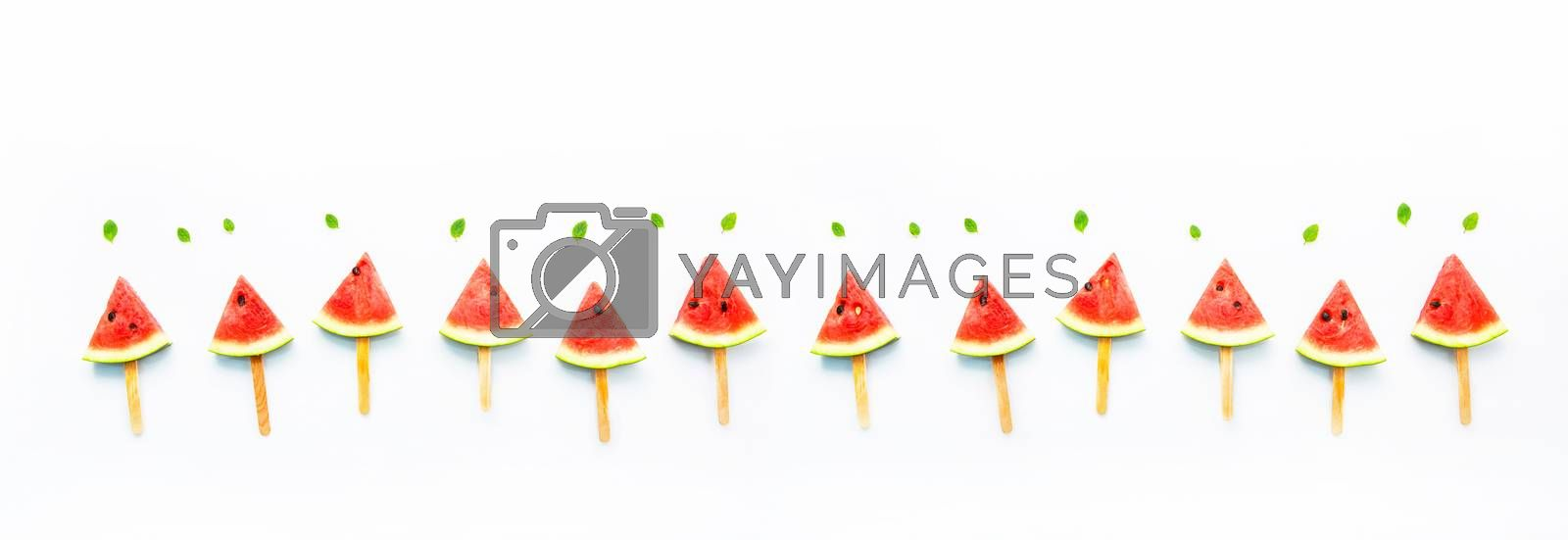 Watermelon slice popsicles and paper mint on white wooden backgr by Bowonpat