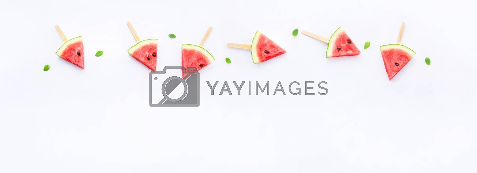 Watermelon slice popsicles on white background by Bowonpat