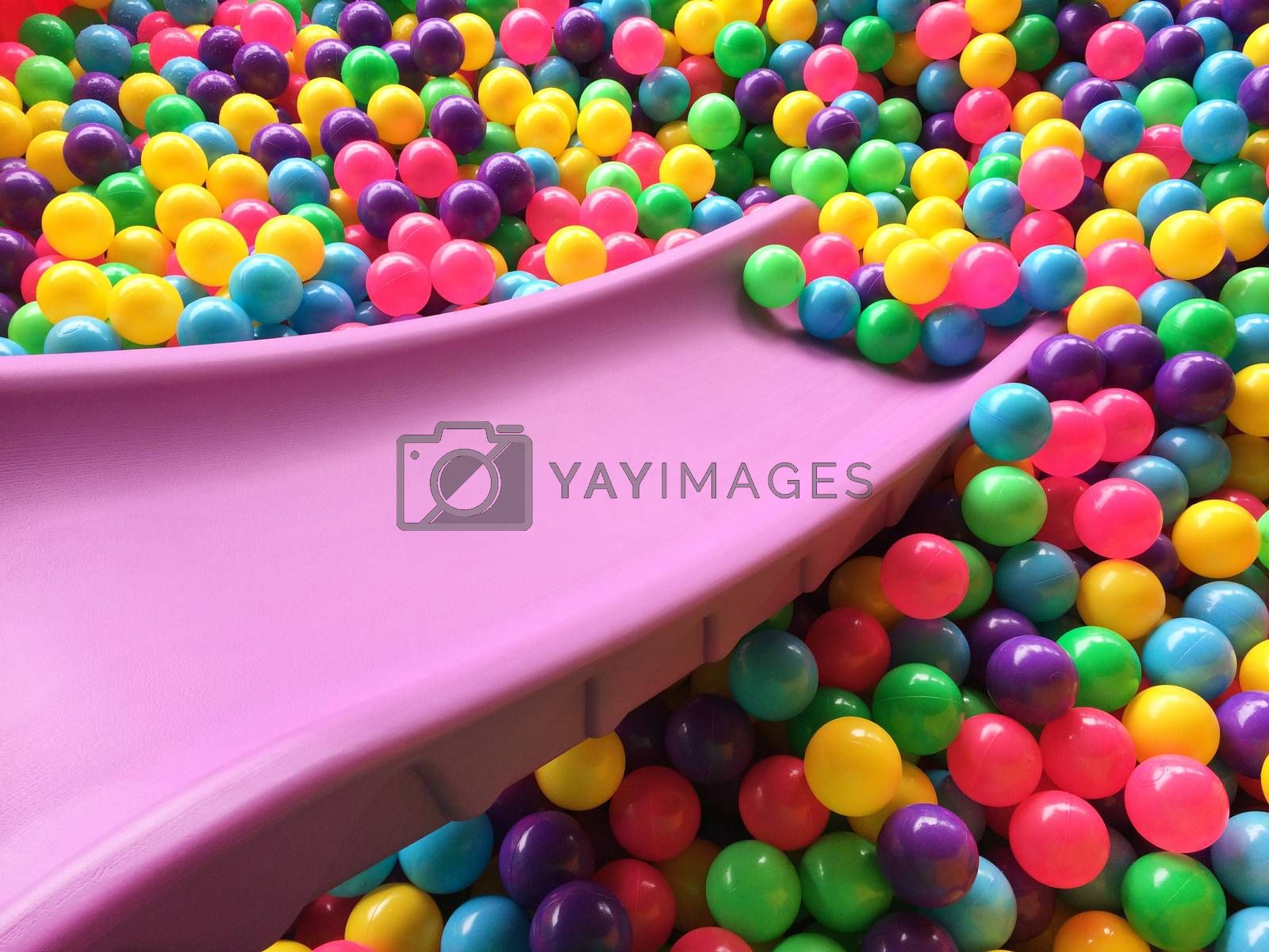 dry children's pool with colorful balls