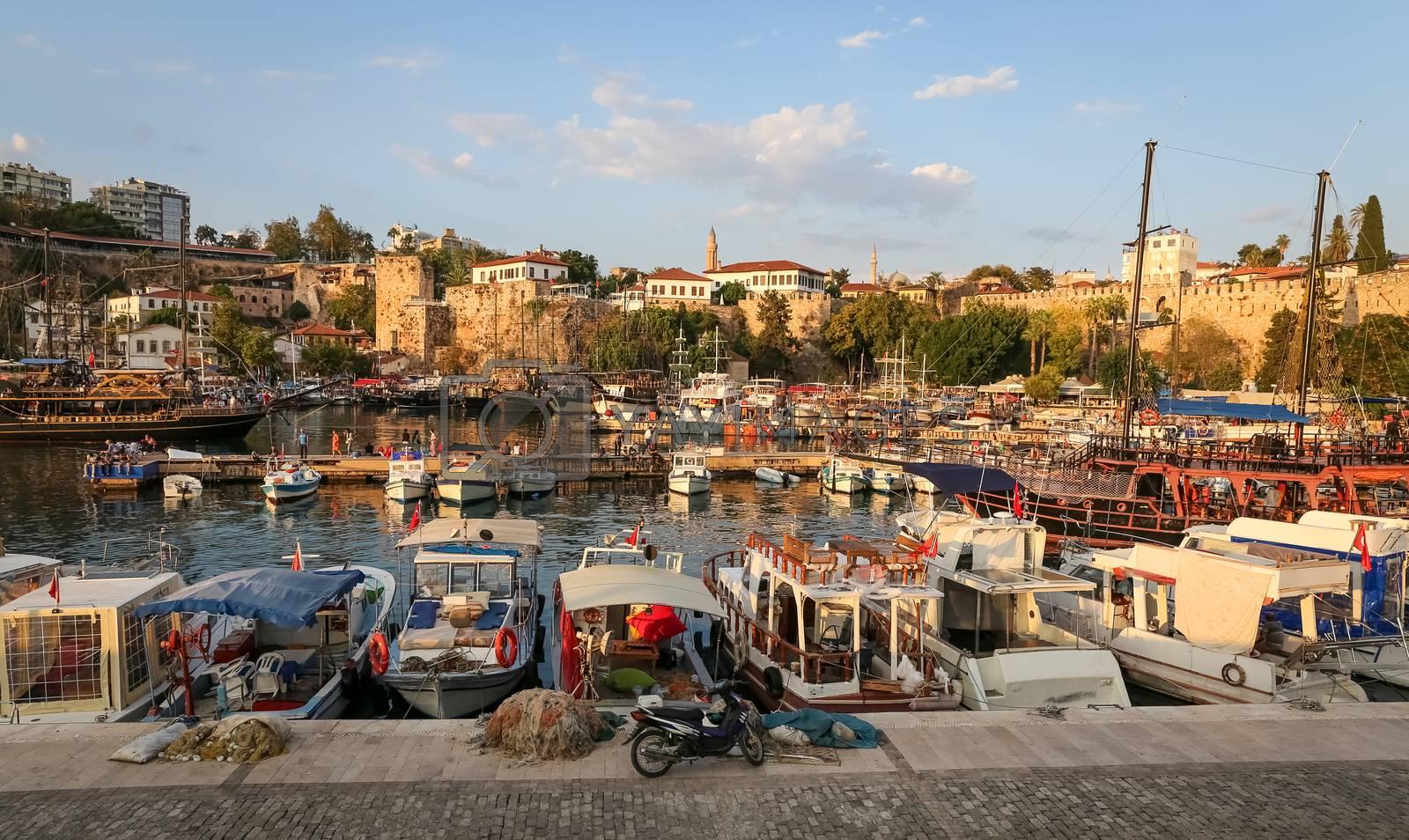 Boats in Antalya Harbour, Turkey by EvrenKalinbacak
