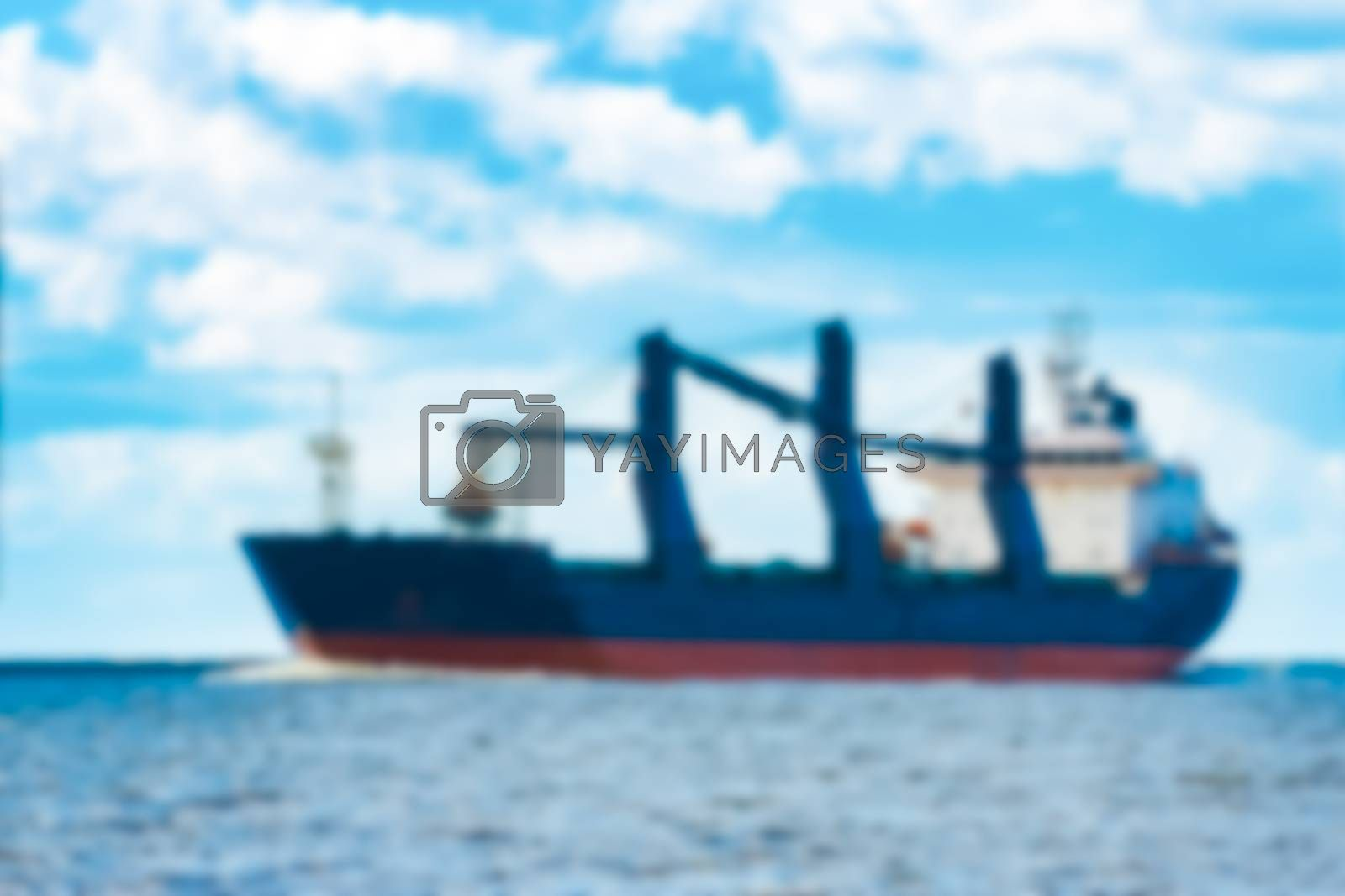 Blue cargo ship - blurred image by New SIGHT Photography