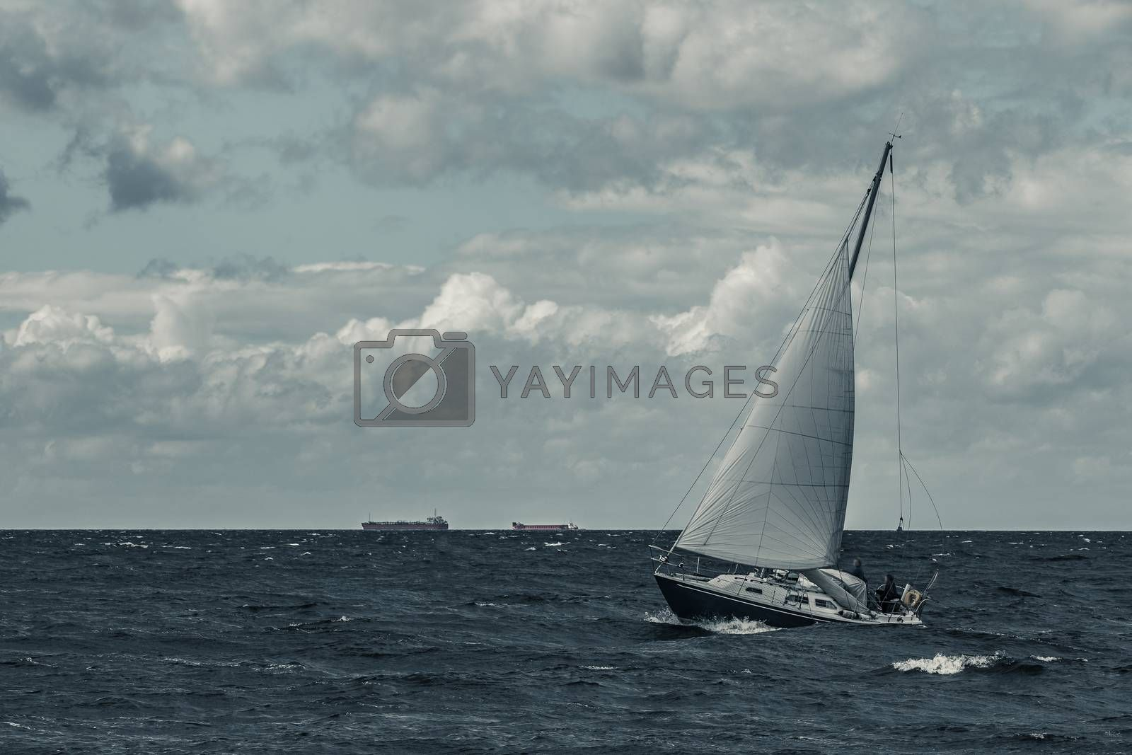 Blue sailboat at storm by New SIGHT Photography