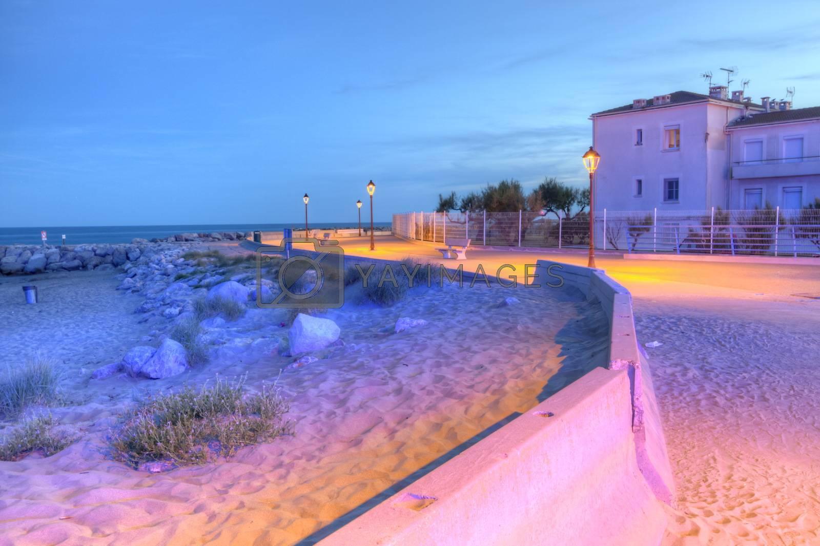 Promenade near mediterranean sea by night, Saintes-Maries-de-la-mer, Camargue, France, HDR