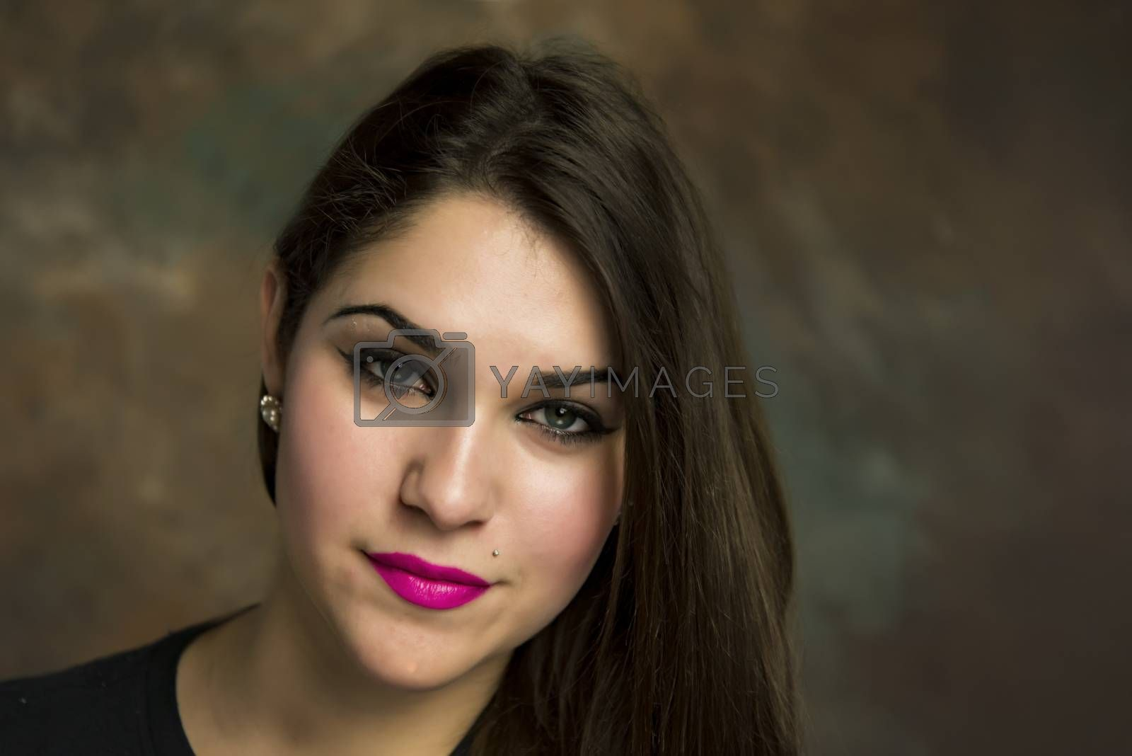 beautiful young woman in her 20s in a close-up portrait in studio