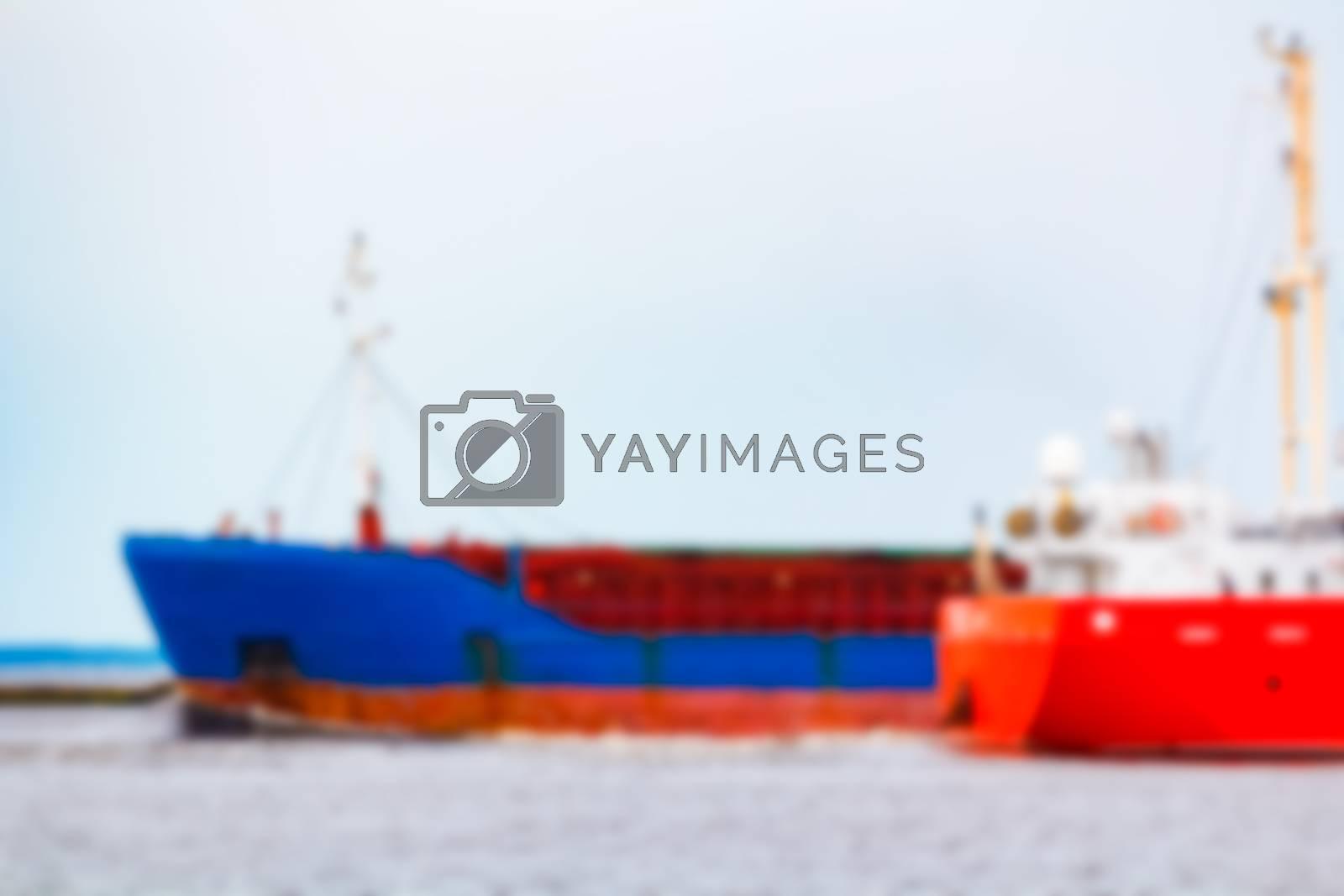Blue cargo ship - soft lens bokeh image. Defocused background