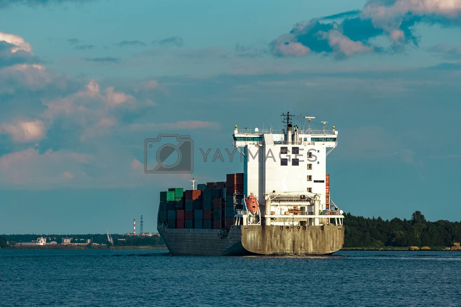 Black container ship. Global logistics and production transfer