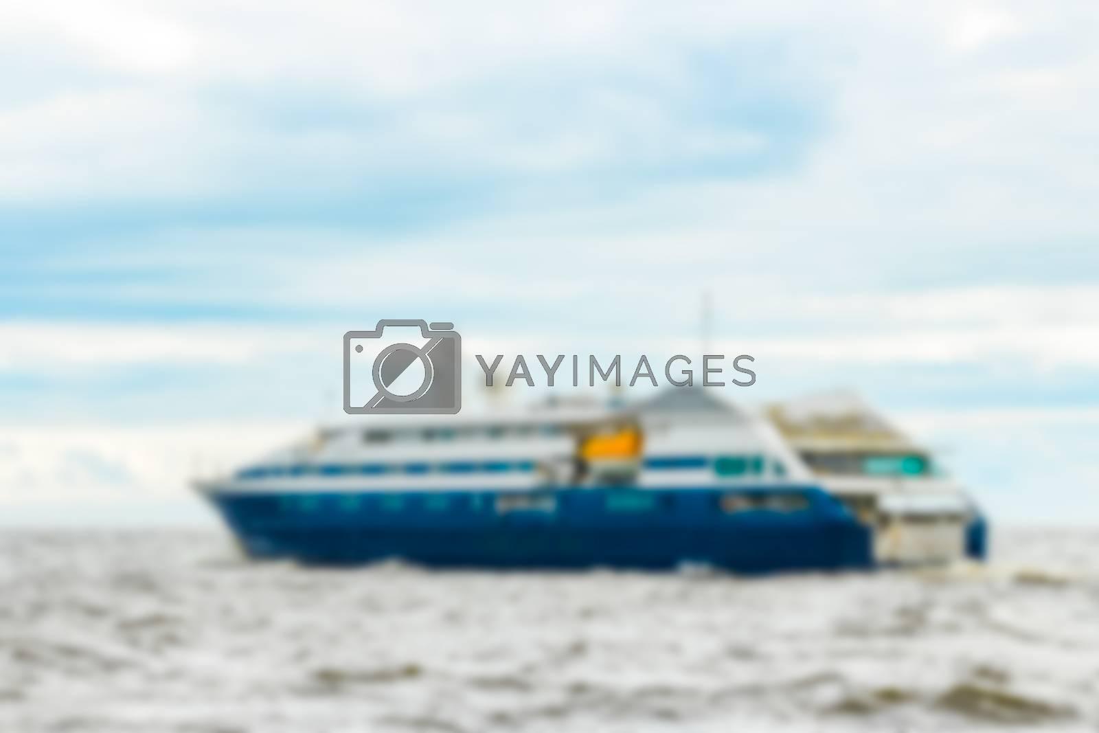 Blue passenger ship - soft lens bokeh image. Defocused background