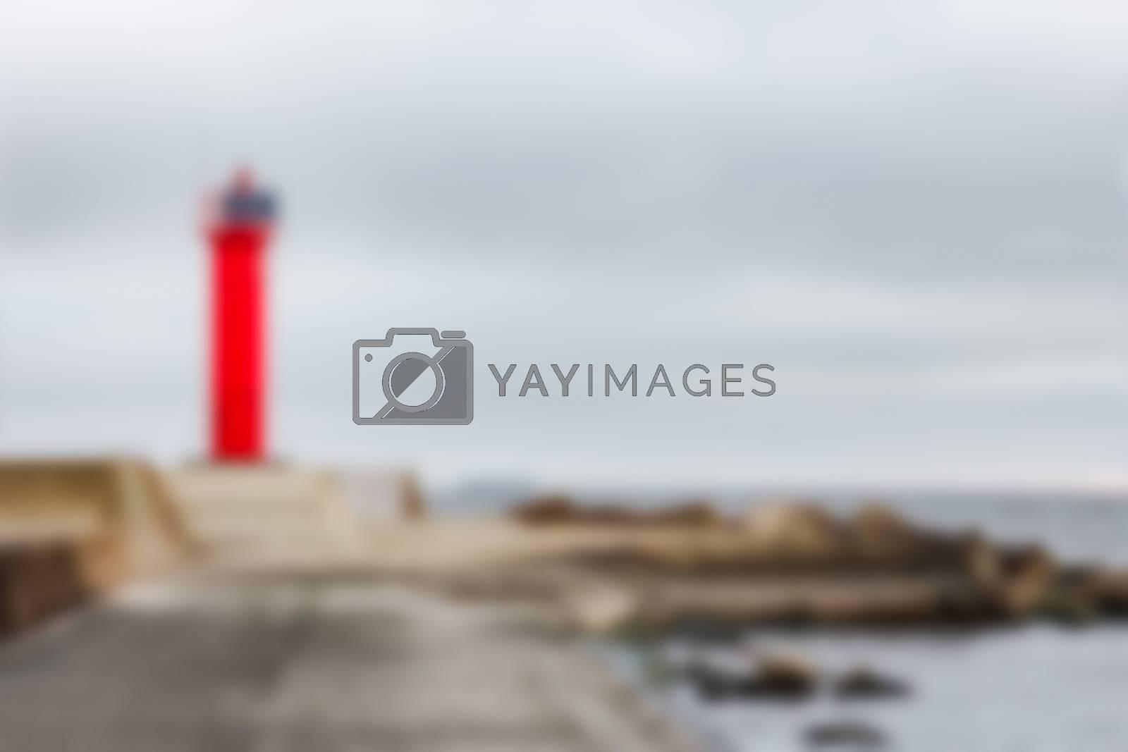 Red lighthouse - soft lens bokeh image. Defocused background