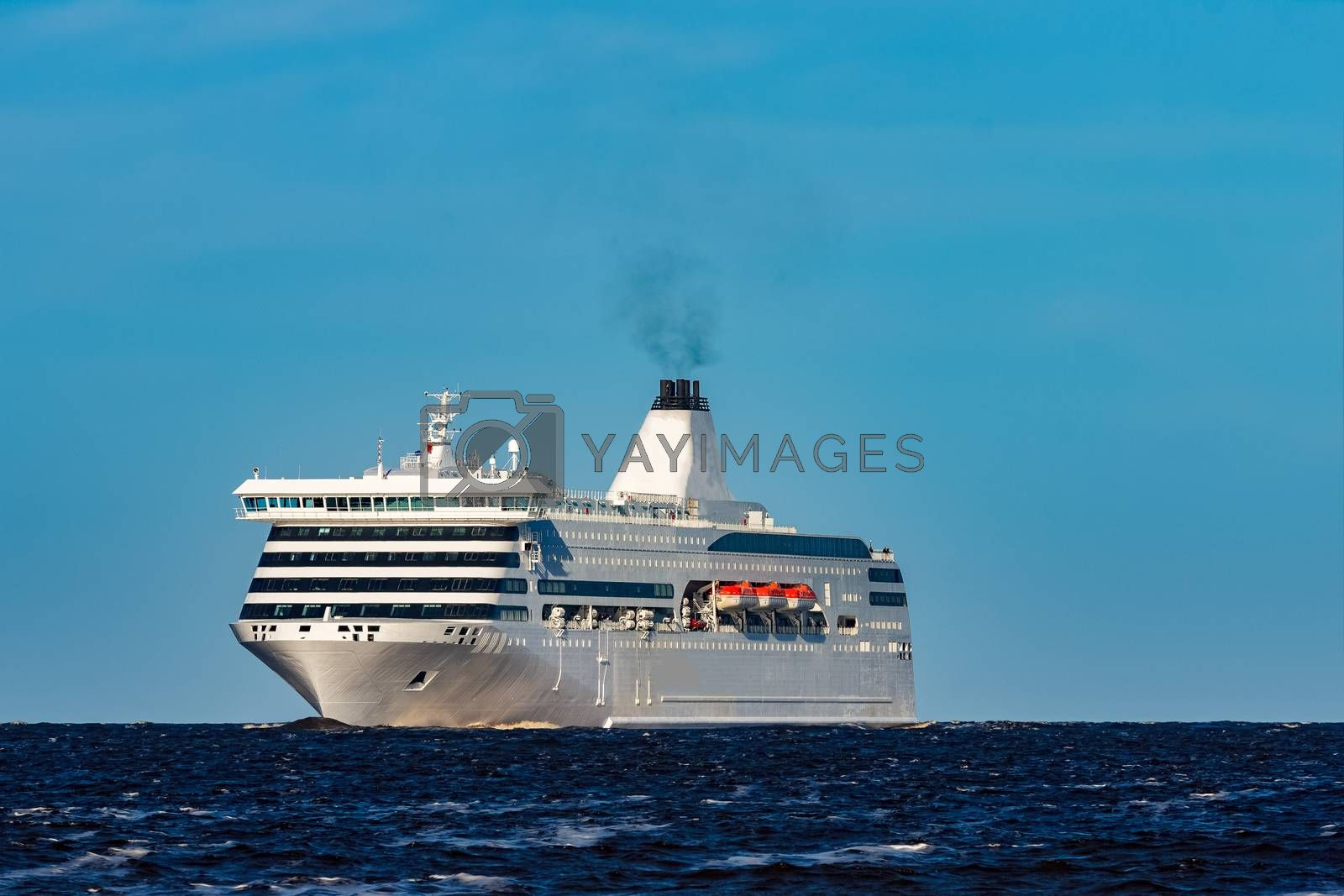 White cruise liner sailing on a clear day