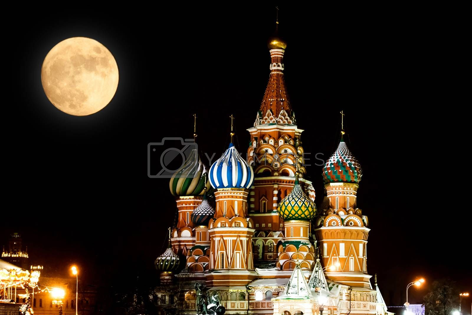 St Basils Cathedral at night and full Moon. Winter season. Moscow, Russia