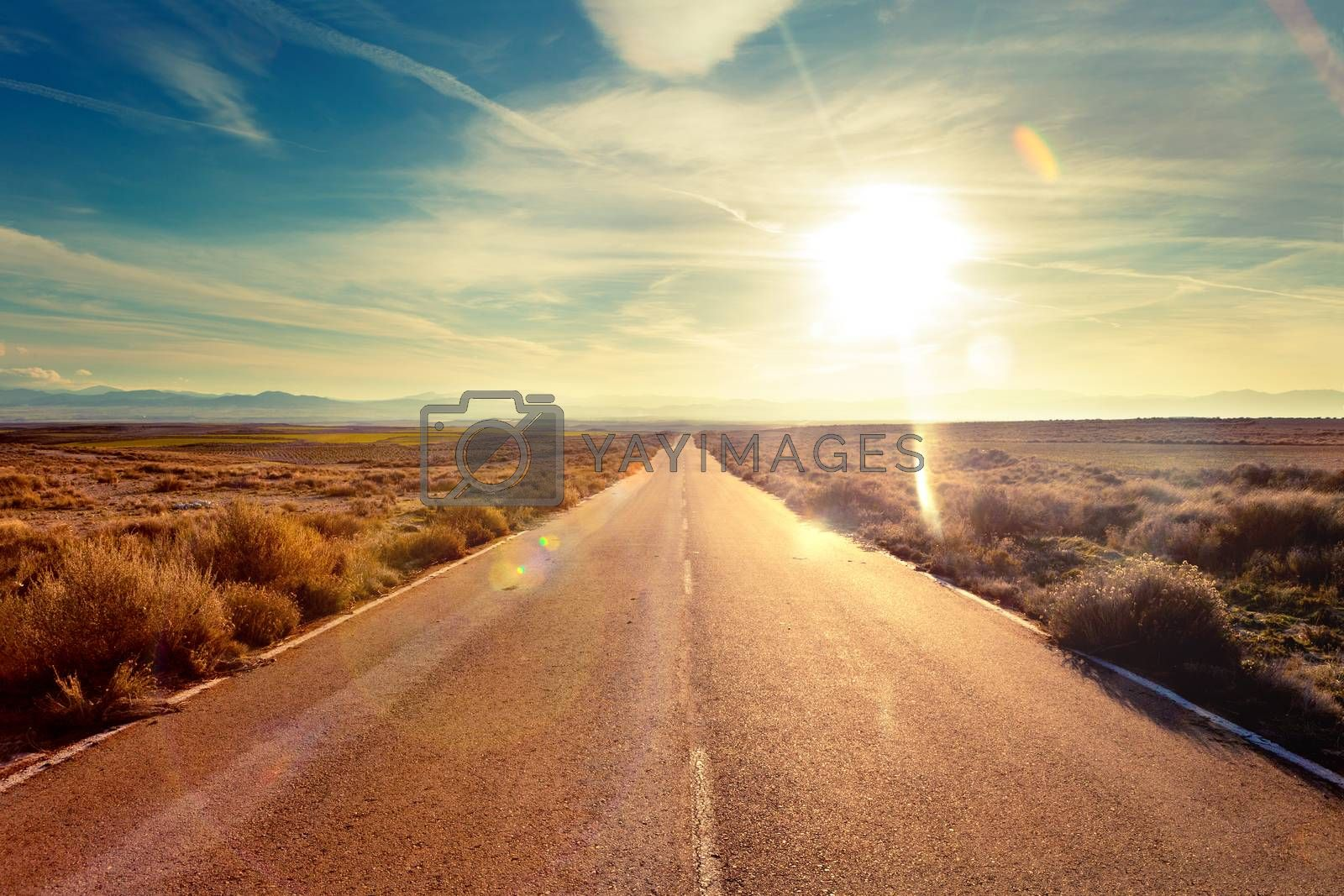 Road through landscape. Road and car travel scenic and sunset.