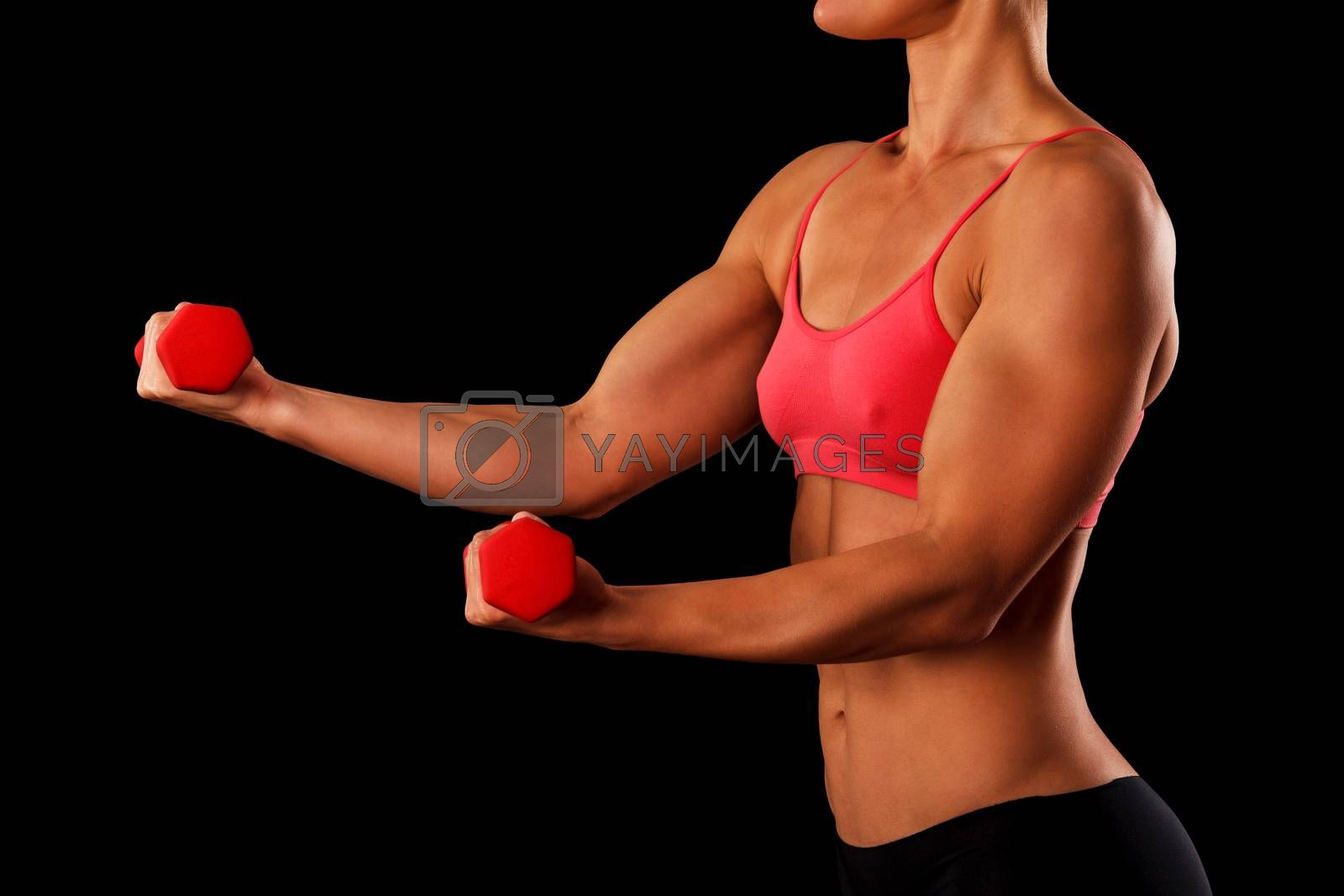 Sporty young woman with dumbbells isolated on black background, closeup shot