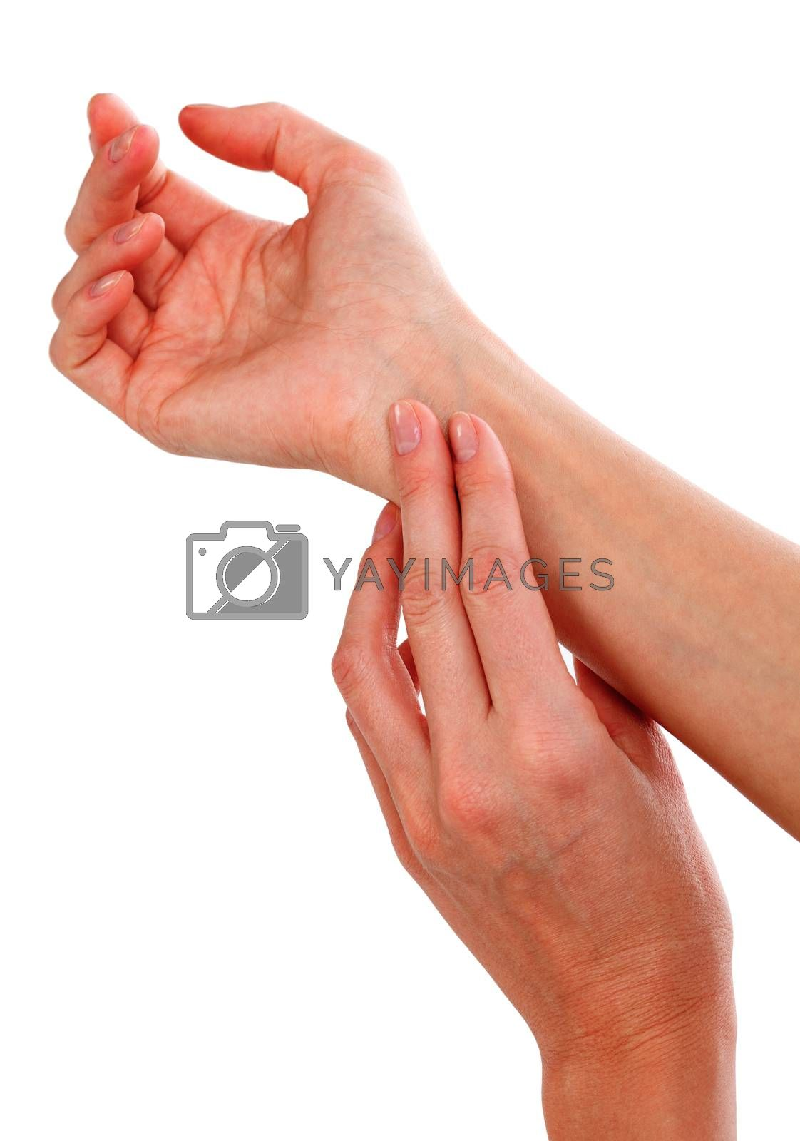 Closeup shot of female hand checking pulse, isolated on white background.