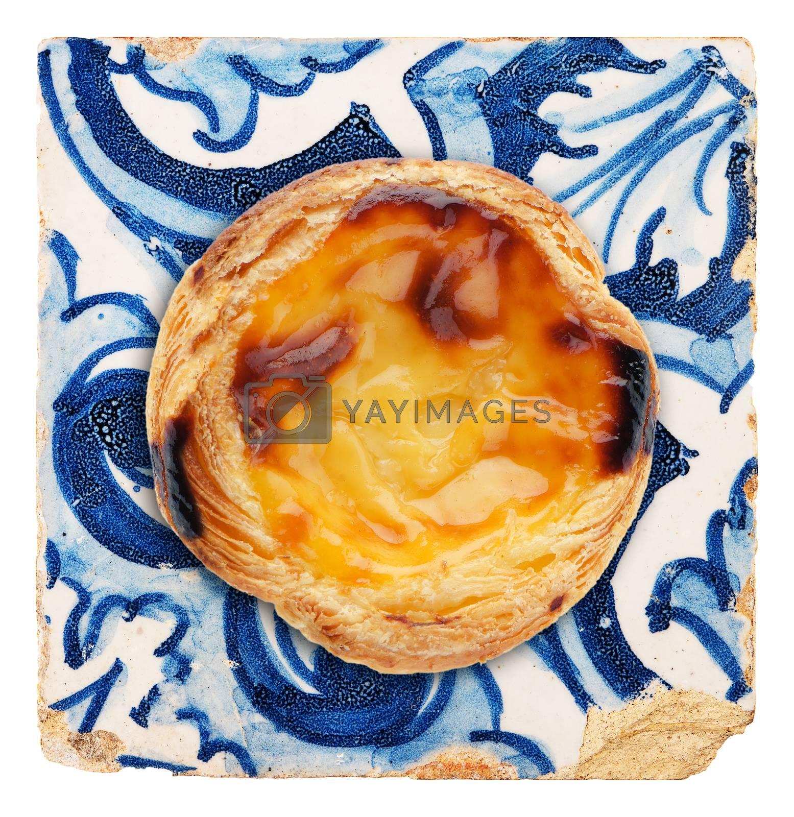 Portuguese dessert pastel de nata on top of old ceramic tile.