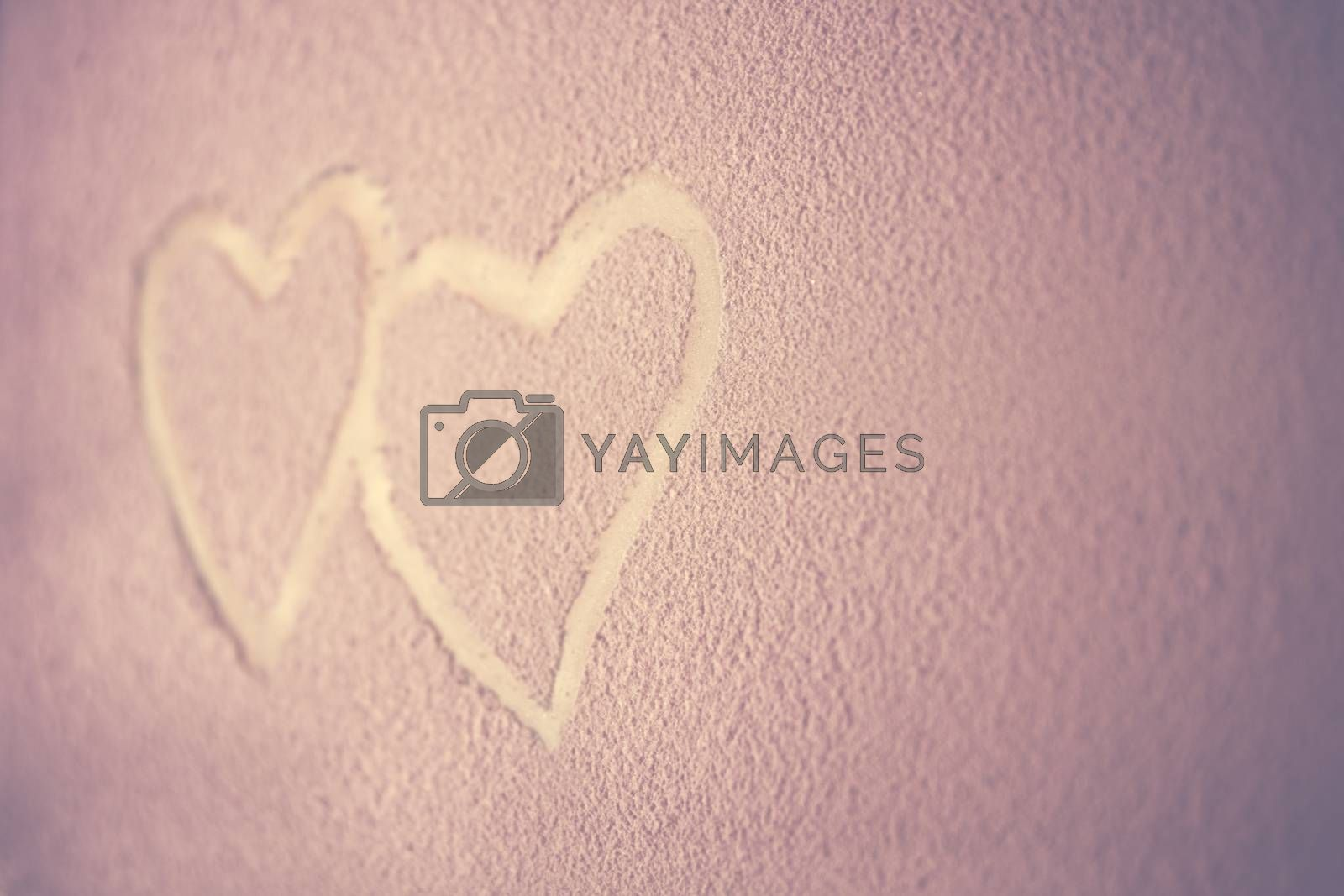 Two hearts, drawing on the snowy background, abstract pink background, heart to heart, romantic message for Valentines day, love concept