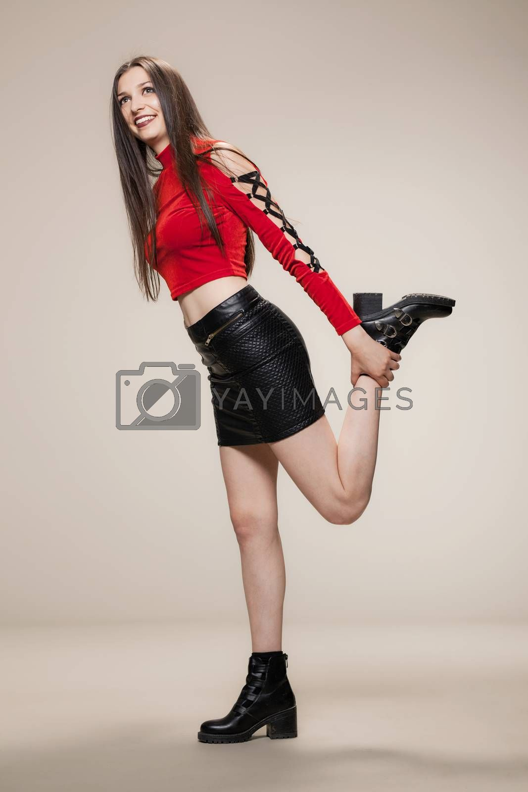 happy girl in red shirt, short black dress and boots