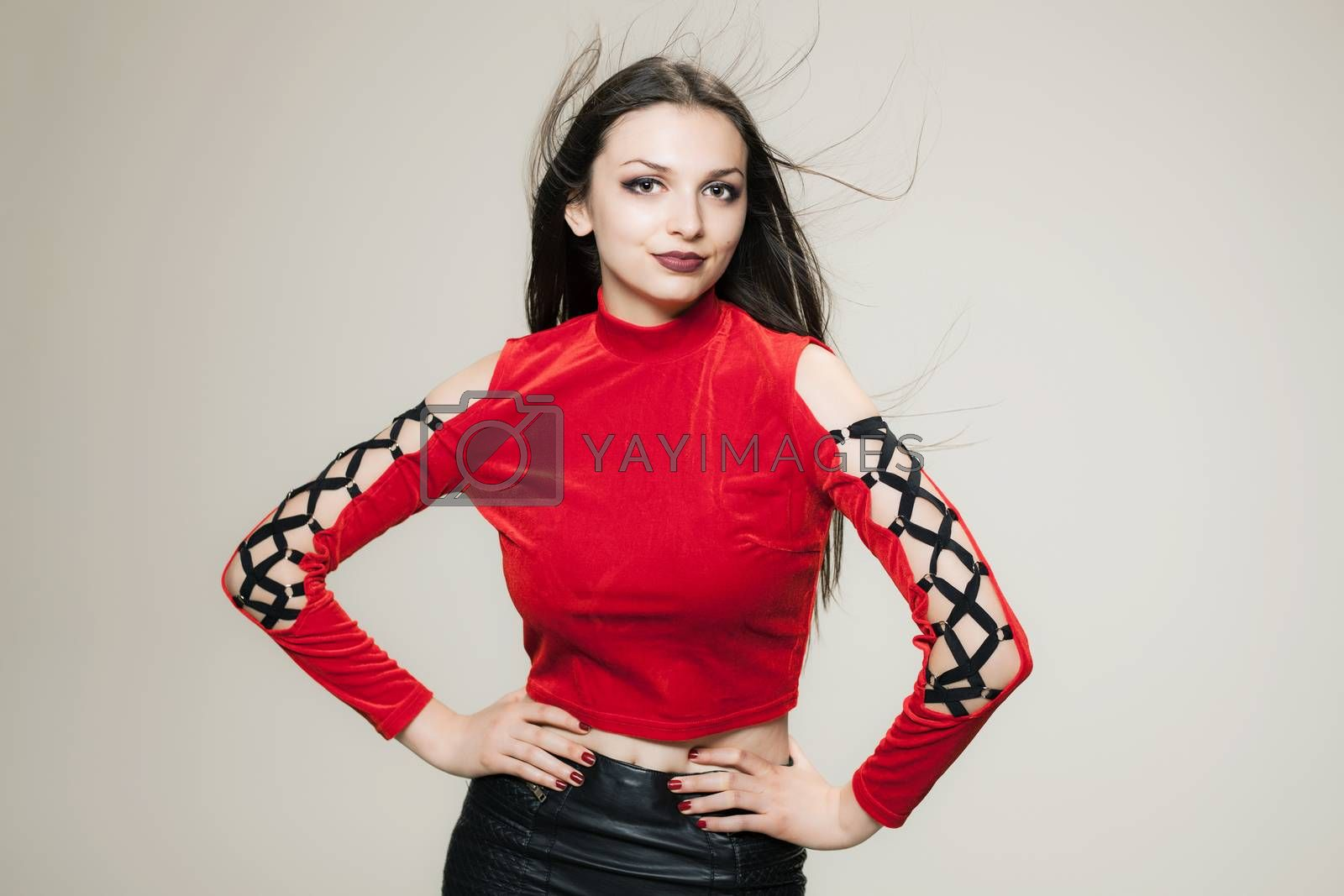 gothic style girl in red shirt, with windy hair